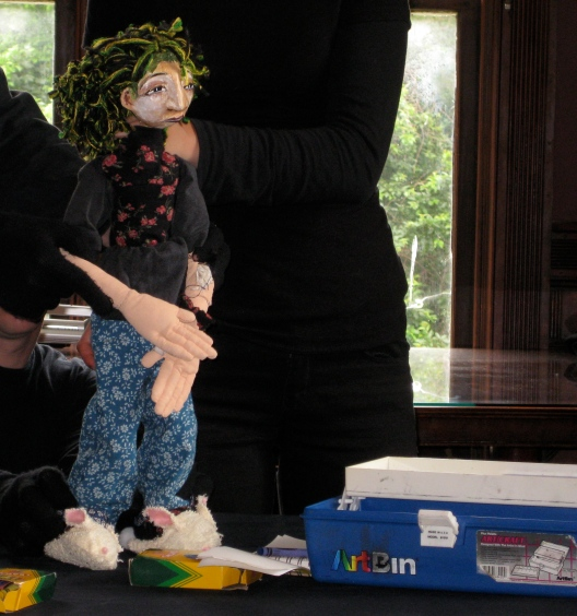 Frightened by her first day in a therapeutic day program, she finds her way in the art room